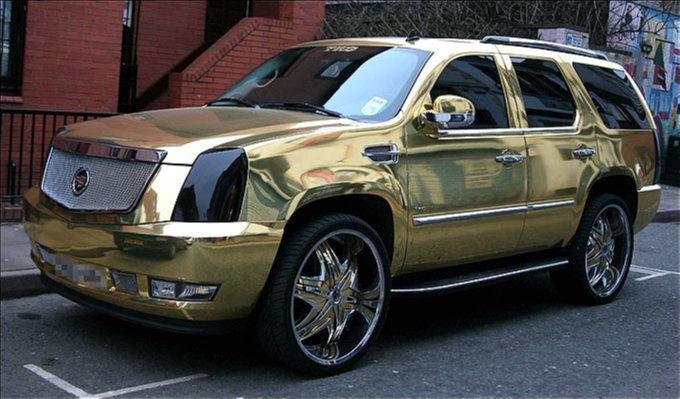 El-Hadji-Dioufs-Gold-Plated-Cadillac-Escalade
