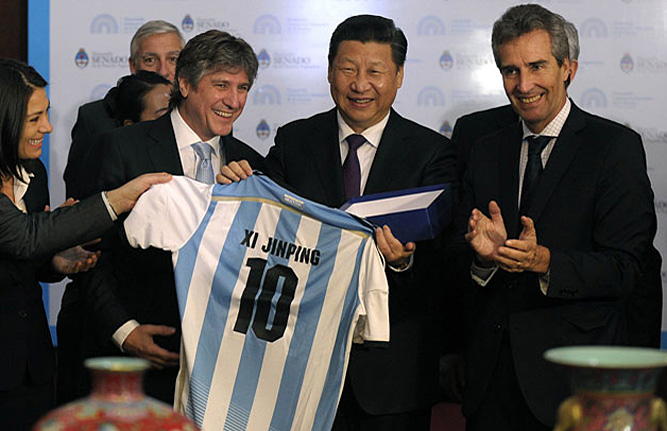 president-xi-jinping-receives-a-jersey-with-his-name-worn-by-argentinean-soccer-superstar-lionel-messi-july-2014