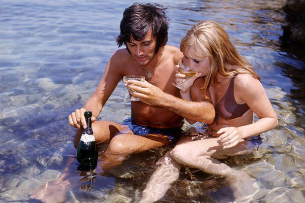 George Best footballer with girlfriend Susan George  on holiday in Majorca   1969